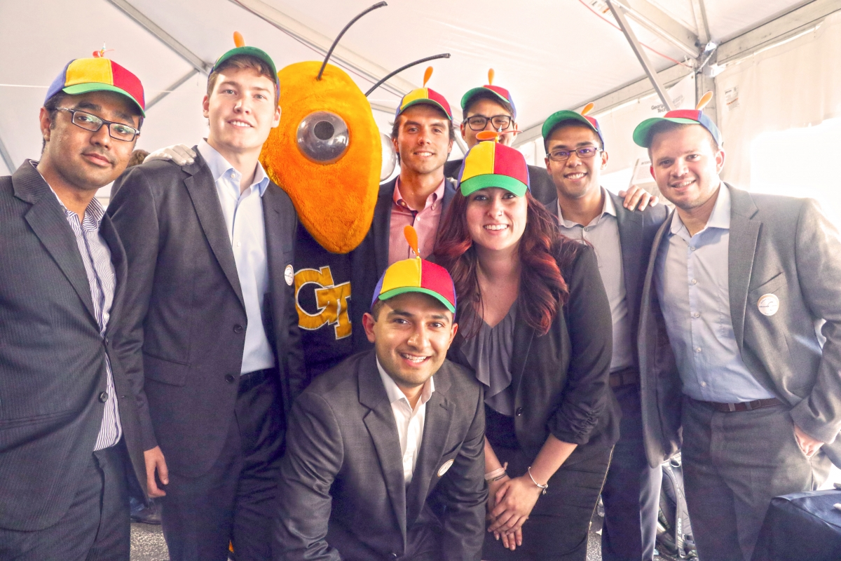 Eight AE students with Buzz, the GT mascot, at the 2017 Design Expo