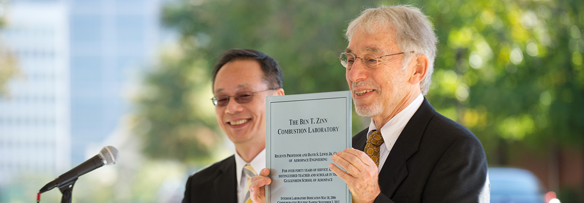 Prof. Zinn holding a plaque commemorating the naming of the Ben T. Zinn Combustion lab