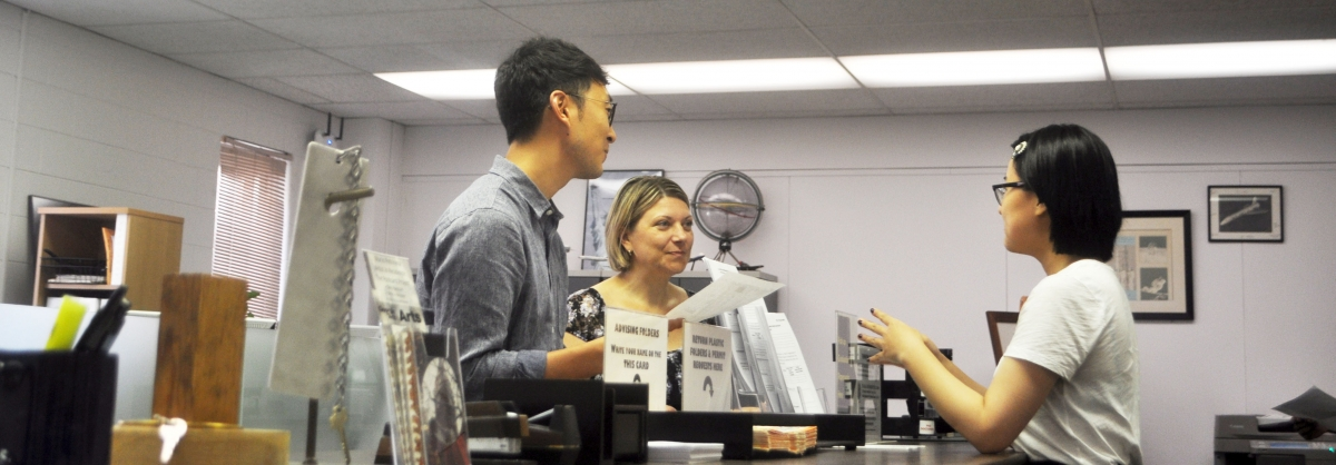 AE Academic Office staff helping a student during registration.