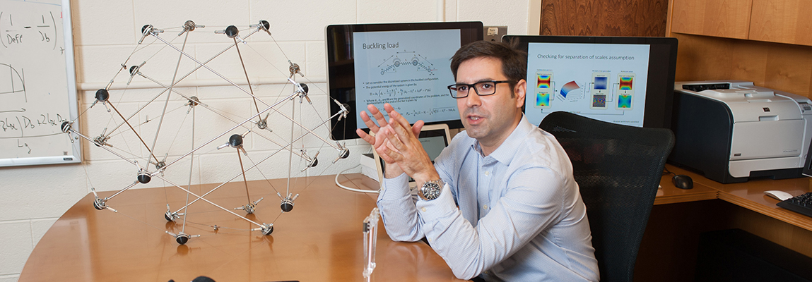 Dr. Julian Rimoli with a wireframe model in his office