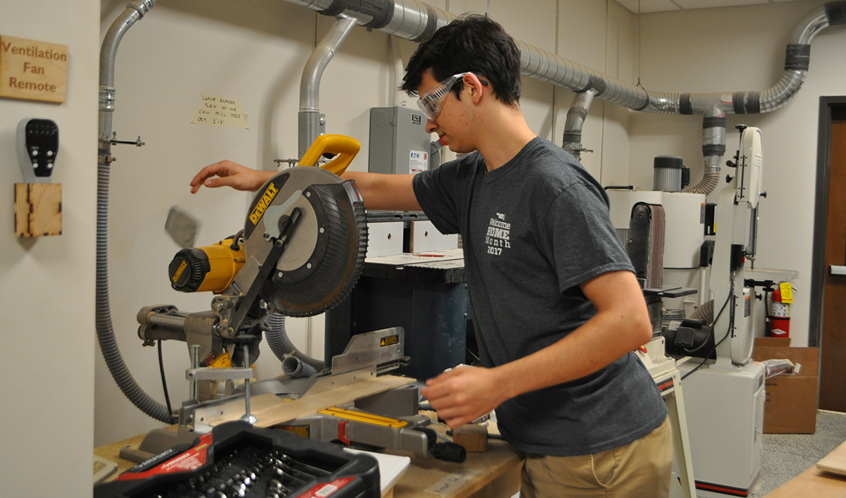 Aerospace Engineering Student Uses the Miter Saw in the Aero Maker Space